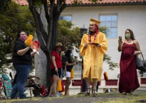 CINDY ELLEN RUSSELL / 2020                                 Roosevelt High School class of 2020 graduate Makalei Chan was greeted with cheers after receiving her degree.