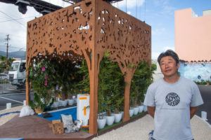 CRAIG T. KOJIMA / CKOJIMA@STARADVERTISER.COM                                 Lighting designer Hideaki Tsutsui stands in front of his installation. The public is invited to book 30-minute visits to the interactive art installation as a way to feel connected with loved ones — past and present — from 5 to 9 p.m. Friday to June 5.