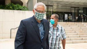 CRAIG T. KOJIMA/ NOV. 30                                 Ex-Honolulu police chief Louis Kealoha leaves Federal Court after his sentencing in November. Behind him is his friend Walter Woods.
