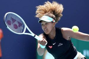 ASSOCIATED PRESS                                 Naomi Osaka, of Japan, returned to Maria Sakkari, of Greece, March 31, during the quarterfinals of the Miami Open tennis tournament in Miami Gardens, Fla. Sponsors of Osaka are sticking by her after she withdrew from the French Open citing mental health issues relating to the press conferences required for players.