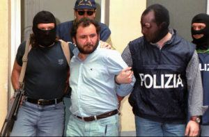 ASSOCIATED PRESS                                 Giovanni Brusca was escorted by masked policemen, in May 1996, outside Police H.Q. in Palermo, Sicily. Giovanni Brusca, 64, was released from prison this week after serving 25 years of a life term for some of Cosa Nostra's most heinous crimes.