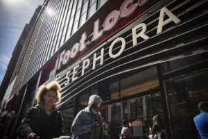 ASSOCIATED PRESS / MAY 7                                 People walk outside a Sephora store in New York.