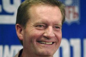 ASSOCIATED PRESS                                 New York Giants coach Jim Fassel smiles as he talks to reporters at Giants Stadium in East Rutherford, N.J., in this Monday, Dec. 30, 2002, file photo. Fassel, a former coach of the New York Giants who was named NFL coach of the year in 1997 and led the team to the 2001 Super Bowl, has died. He was 71.
