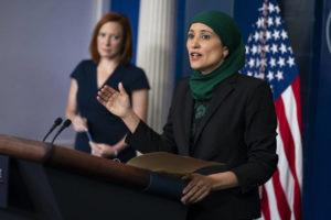 ASSOCIATED PRESS                                 White House press secretary Jen Psaki listens as deputy director of the National Economic Council Sameera Fazili speaks during a press briefing at the White House today.