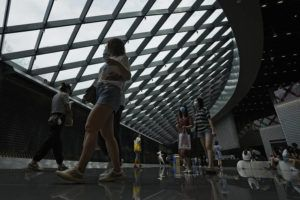 ASSOCIATED PRESS                                 People wearing face masks to help curb the spread of the coronavirus visit a shopping mall in Beijing.