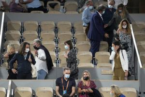ASSOCIATED PRESS                                 Spectators leave to respect the 11PM curfew due to the COVID-19 pandemic while Italy's Matteo Berrettini plays Serbia's Novak Djokovic in a quarterfinal match of the French Open tennis tournament at the Roland Garros stadium today in Paris.