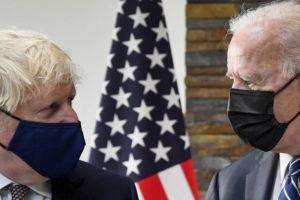 ASSOCIATED PRESS                                 U.S. President Joe Biden, right, talks with Britain's Prime Minister Boris Johnson, during their meeting ahead of the G7 summit in Cornwall, Britain, today.