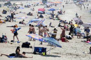 ASSOCIATED PRESS                                 Beachgoers crowd in the heat at Santa Monica Beach today in Santa Monica, Calif.