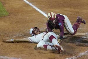 ASSOCIATED PRESS                                 Oklahoma's Tiare Jennings, left, is tagged out at the plate by Florida State catcher Anna Shelnutt during the seventh inning.