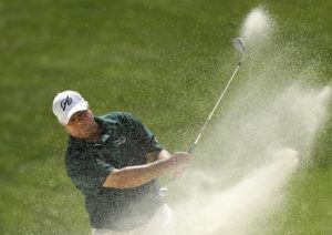 ASSOCIATED PRESS / 2014                                 Scott Simpson hits out of a bunker on the ninth green during the final round of the Champions Tour's Principal Charity Classic golf tournament in Des Moines, Iowa.