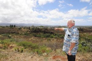 COURTESY SAVIO SOLAR POWER SOLUTIONS                                 Peter Savio points at a lot in Waikele where he plans to build a solar farm that would be sold as units, condominium-style, to buyers.