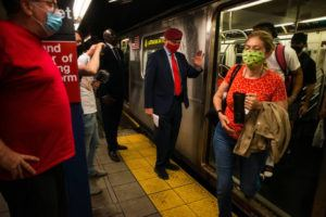 NEW YORK TIMES / MAY 18 Curtis Sliwa, a New York mayoral candidate, greets people on the subway in New York.