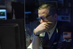 ASSOCIATED PRESS                                 Specialist Gregg Maloney worked on the floor of the New York Stock Exchange, today. Resurgent pandemic worries knocked stocks lower from Wall Street to Tokyo today, fueled by fears that a faster-spreading variant of the virus may upend the economy's strong recovery.