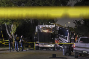 ASSOCIATED PRESS                                 ATF investigators are seen next to the remains of an armored Los Angeles Police Department tractor-trailer after fireworks exploded on June 30. Los Angeles bomb technicians grossly miscalculated the weight of homemade fireworks last month when they detonated them in a containment chamber, causing a catastrophic explosion that injured 17 people and rocked a neighborhood, the police chief said today.