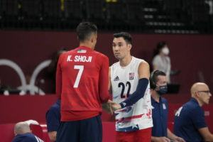 ASSOCIATED PRESS                                 Kawika Shoji and Erik Shoji of the United States' talk on the court today during a men's volleyball preliminary round pool B match against France, at the 2020 Summer Olympics in Tokyo, Japan.