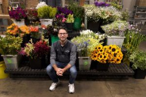 ASSOCIATED PRESS                                 Steven Dyme, owner of Flowers for Dreams, poses for a portrait at his warehouse Friday, in Chicago.
