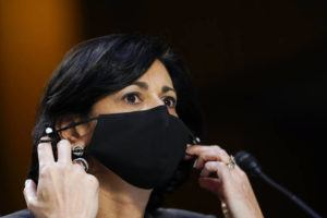 """ASSOCIATED PRESS / MARCH 18                                 Dr. Rochelle Walensky, director of the Centers for Disease Control and Prevention, says new mask-wearing guidance, coupled with higher rates of vaccination against COVID-19, could halt the current escalation of infections in """"a couple of weeks."""" Walensky is seen here adjusting her face mask during a Senate committee hearing on the federal coronavirus response on Capitol Hill in March."""