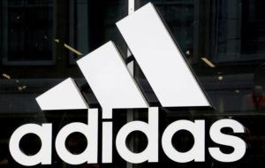 ASSOCIATED PRESS                                 The logo of the sports goods manufacturer Adidas, seen in May 2019, in Berlin, Germany. The University of Hawaii has reached an apparel and equipment deal with Adidas.