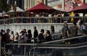 ASSOCIATED PRESS / APRIL 24                                 People walk as others dine on the Las Vegas Strip, in Las Vegas.