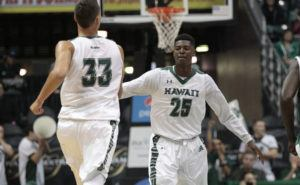 2016 January 6 SPT - Honolulu Star-Advertiser photo by Krystle Marcellus Hawaii Warriors forward Michael Thomas (25) congratulates Hawaii Warriors forward Stefan Jankovic (33), right after he scores in the first half of an NCAA men's basketball game between the Hawaii Warriors and Cal Poly Mustangs at the Stan Sheriff Center in Manoa on Wednesday, January 6, 2016.