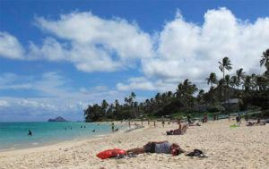 ASSOCIATED PRESS / 2013                                 People at Lanikai Beach, a popular neighborhood for vacation rentals in Kailua, in 2013.