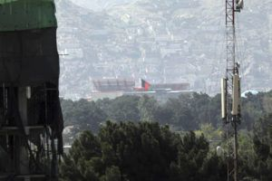 ASSOCIATED PRESS                                 The Afghan flag flies atop the presidential palace in Kabul, Afghanistan.