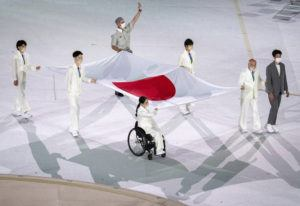 OIS VIA AP                                 Japanese athletes Miki Matheson, Mineho Ozaki, Taiyou Imai, Erina Yuguchi, Kaori Icho, and Tskumi Asatani carry the national flag of Japan into the Olympic Stadium at the start of the Paralympic Opening Ceremony Tokyo 2020 Paralympic Games in Tokyo.