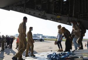 ETAT MAJOR DES ARMEES VIA AP                                 A photo provided by the French Army shows Afghan refugees arriving in a military plane at Roissy airport, north of Paris, on Wednesday.