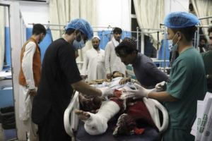 ASSOCIATED PRESS                                 A victim receives medical assistance in a hospital after he was wounded in the deadly attacks outside the airport in Kabul, Afghanistan, on Thursday.