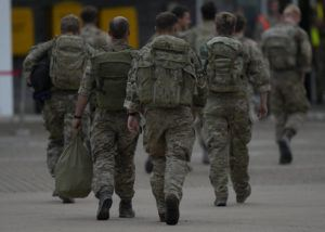 ASSOCIATED PRESS                                 Members of the British armed forces 16 Air Assault Brigade walk to the air terminal after disembarking a Royal Airforce Voyager aircraft at Brize Norton, England, as they return from helping in operations to evacuate people from Kabul airport in Afghanistan.