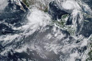COURTESY NOAA                                 This image provided by the National Oceanic and Atmospheric Administration (NOAA) shows severe weather systems, Hurricane Nora, upper left, and Hurricane Ida, upper right, over the North American continent on Saturday. Hurricane Nora is churning northward up Mexico's Pacific Coast toward the narrow Gulf of California, after making a sweep past the Puerto Vallarta area.