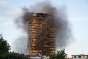 ASSOCIATED PRESS                                 Smoke billows from a building in Milan, Italy, today. Firefighters were battling a blaze that spread rapidly through a recently restructured 60-meter-high, 16-story residential building in Milan. There were no immediate reports of injuries or deaths.