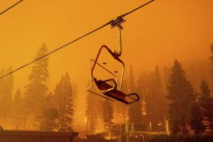 ASSOCIATED PRESS                                 Seen in a long camera exposure, the Caldor Fire burned as a chairlift sat motionless at the Sierra-at-Tahoe ski resort, Sunday, in Eldorado National Forest, Calif. The main buildings at the ski slope's base survived as the main fire front passed.