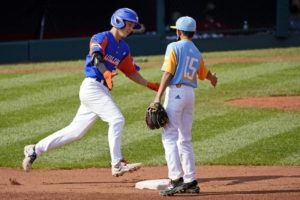 ASSOCIATED PRESS                                 Michigan's Cameron Thorning was greeted by Honolulu shortstop Kekoa Payanal as he rounded second after hitting a two-run home run off starting pitcher Micah Bennett during the first inning of a baseball game at the Little League World Series in South Williamsport, Pa., today.