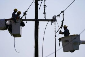 ASSOCIATED PRESS                                 Crews work on power lines that were damaged in the aftermath of Hurricane Ida today in LaPlace, La.