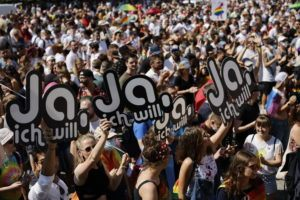 MICHAEL BUHOLZER/KEYSTONE VIA AP                                 People gather for the Zurich Pride parade in Zurich, Switzerland. On Sept. 26, 2021 Swiss citizens will vote on the proposal of 'Marriage for everyone' (Ehe fuer alle), allowing marriage for same-sex couples.