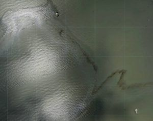 NOAA VIA AP / AUG. 31                                 Photos captured by National Oceanic and Atmospheric Administration aircraft and reviewed by The Associated Press show a miles long black slick floating in the Gulf of Mexico near a large rig marked with the name Enterprise Offshore Drilling. The company, based in Houston, did not immediately respond to requests for comment by phone or email on Wednesday. EPA officials said Wednesday hey were unaware of any leak requiring a federal response.