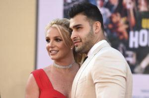 """JORDAN STRAUSS/INVISION/ASSOCIATED PRESS                                 Britney Spears and Sam Asghari arrived at the Los Angeles premiere of """"Once Upon a Time in Hollywood,"""" at the TCL Chinese Theatre, in July 2019. Spears announced on Instagram, Sunday, that she and Asghari are engaged. The couple met on the set of her """"Slumber Party"""" music video in 2016."""