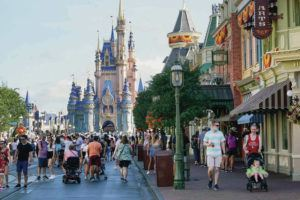 ASSOCIATED PRESS / AUG. 30                                 Guests stroll along Main Street at the Magic Kingdom theme park at Walt Disney World Monday, Aug. 30, 2021, in Lake Buena Vista, Fla. The park will celebrate its 50th anniversary on Oct. 1.