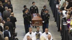 THE WICHITA EAGLE VIA AP                                 A Fort Riley honor guard carries the remains of Father Emil to an alter during Kapaun's funeral mass today Wichita, Kan.