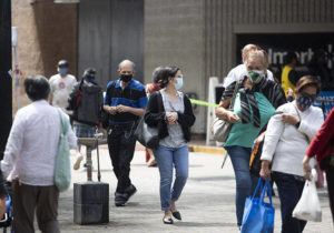 CINDY ELLEN RUSSELL / CRUSSELL@STARADVERTISER.COM                                 People wearing masks as they walked along Fort Street Mall in downtown.