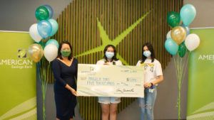 COURTESY STATE OF HAWAII                                 Angela Yao, center, is the second winner of the $5,000 cash prize offering from American Savings Bank as part of the state's COVID-19 vaccination incentive campaign. ASB is offering a total of three cash prizes for the campaign.