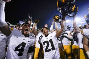 ASSOCIATED PRESS                                 Iowa players celebrate after defeating Maryland 51-14 during an NCAA college football game Friday in College Park, Md.