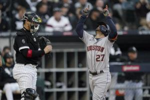 ASSOCIATED PRESS                                 Houston Astros' Jose Altuve (27) celebrated his home run as Chicago White Sox catcher Yasmani Grandal looked on in the ninth inning during Game 4 of a baseball American League Division Series today, in Chicago.