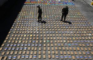 ASSOCIATED PRESS / 2017                                 Police officers walk among packages of seized cocaine at the Pacific port of Buenaventura, Colombia, after about one ton of cocaine was seized in a container during an operation by counternarcotics police at the port. In 2018, Capt. Juan Pablo Mosquera, a Colombian national police officer who was part of an elite unit that worked closely with U.S. anti-narcotics agents, was extradited to Miami to stand trial on charges he betrayed the U.S. Drug Enforcement Administration to the same traffickers they were jointly fighting.