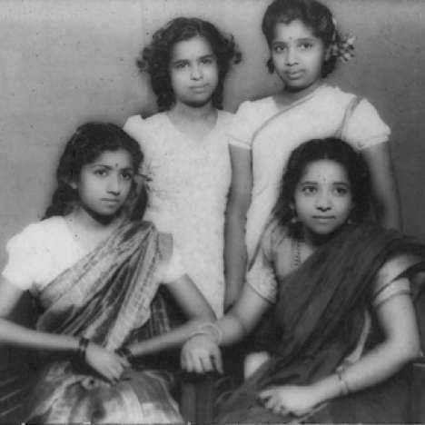 Asha with her sisters in childhood