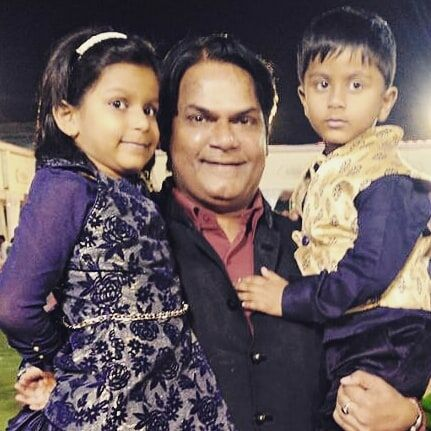 Akhilendra Mishra with his son and daughter
