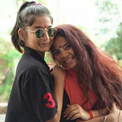 Vartika Jha with her sister