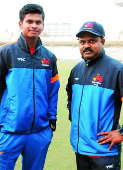 Shreyas Iyer with coach Pravin Amre