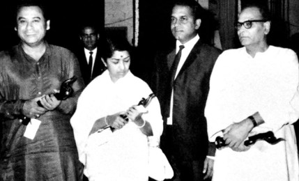 Kishore Kumar Holding His Filmfare Award Alongside Lata Mageshkar, And S. D. Burman